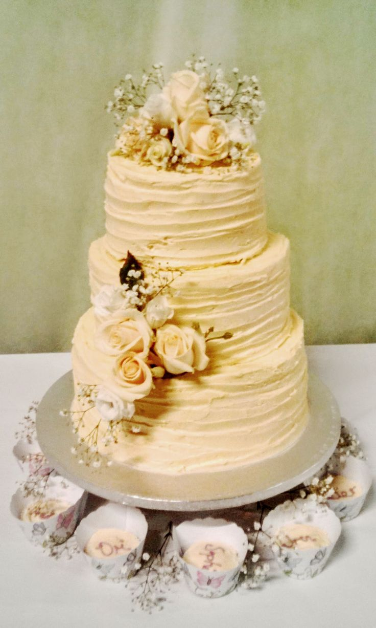 3 Tier Wedding Cake With Butter Cream Covering Dressed