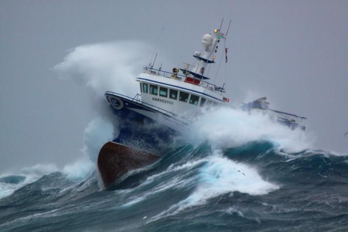 A Newfoundland Crab boat, owned by Ross Petten from Port de Grave, navigates some choppy water on the Grand Banks off Newfoundland .
