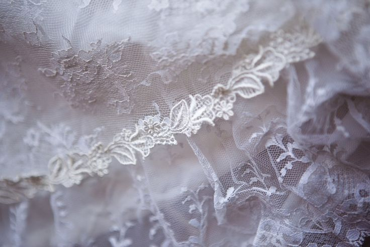 How to Repurpose a Vintage Wedding Dress! What will you do with your mother's wedding dress? This wedding dress was from a bride's mom and we used the lace and trim at the bottom to make the bride a ring pillow and a wedding garter.