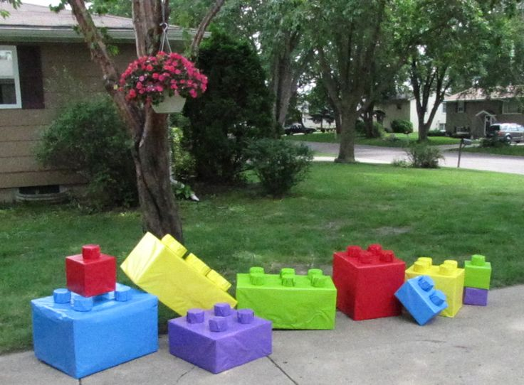 "Giant Legos  Use different shapes of boxes and wrap in bright Lego colors.  For the ""nubs"" we used a paper roll for a large roll of paper.  We cut them into 2"" high pieces and arranged them on the boxes to resemble real Legos.  The kids LOVED them!!"
