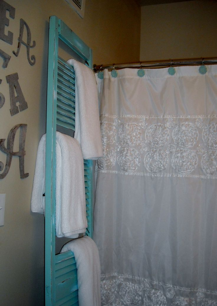I found an old shutter and then painted it, roughed it up and took some slits out to make a towel rack in my bathroom! found the shutter for $3 ! what a steal!