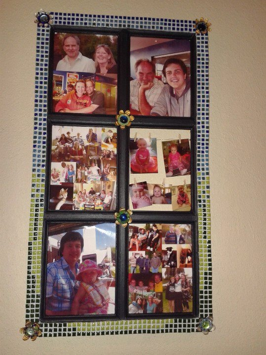 """The whole frame (old window frame). I'm rather fond of the """"washing line"""" effect in the middle right section. You can change the pictures - great for growing babies."""