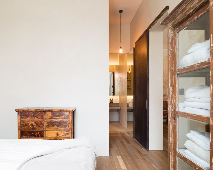 Refurbishment of terraced home in Belsize Park, London.  Bedroom. Interior Design.  Solid Timber Floor by Ted Todd. Joinery by Goldcrest of London. Photographer - Jim Stephenson. Contractor - Mallett Construction.