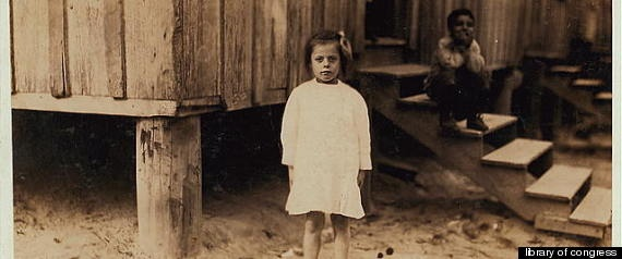 Peerless Oyster Co.  Eight-year-old Emma Kelly picks shrimp from 3 a.m. until 4 p.m. in Bay St. Louis, Mississippi in 1911.
