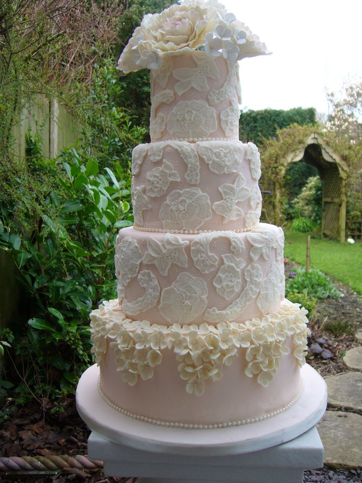 wedding cakes northern new jersey%0A Blush pink four tier wedding cake with sugar lace and hydrangea blossoms  with large ivory sugar