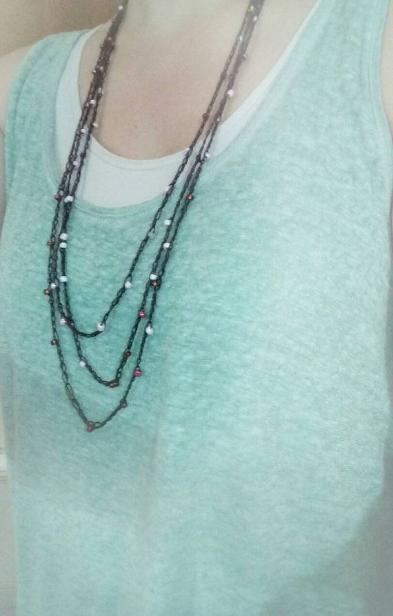 Check out this item in my Etsy shop https://www.etsy.com/listing/399904469/handmade-crocheted-chain-with-beads-long