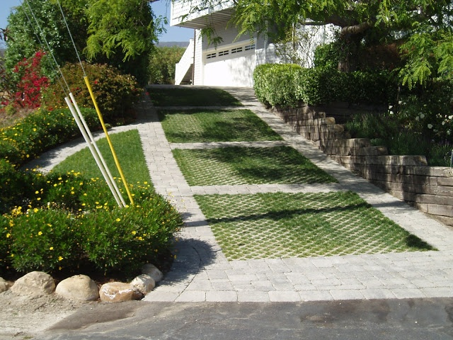 15 best camp slope driveway images on pinterest for Sloped driveway options