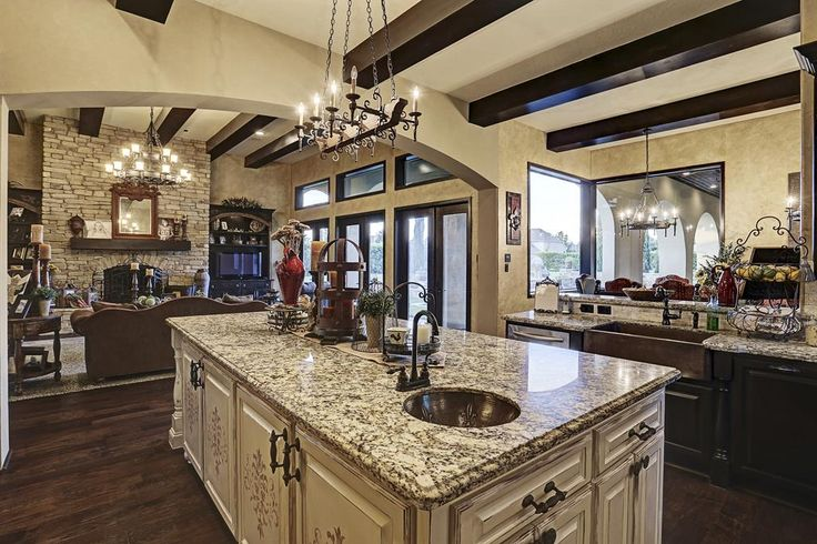 Kitchen includes a copper prep and farmhouse sink, designer stenciled island and waterfall granite.  Large picture windows draw your eye to the dining area.