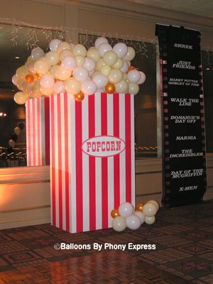 "hollywood balloon arch | giant bucket of popcorn completes the ""Night at the movies"" theme."