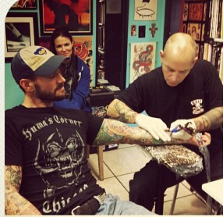 Let's not forget CM Punk got a tattoo that resembled Lita before they broke up... Awkward!