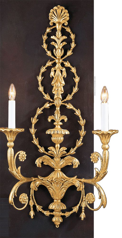 carved wood Adam style wall sconce in gold-leaf