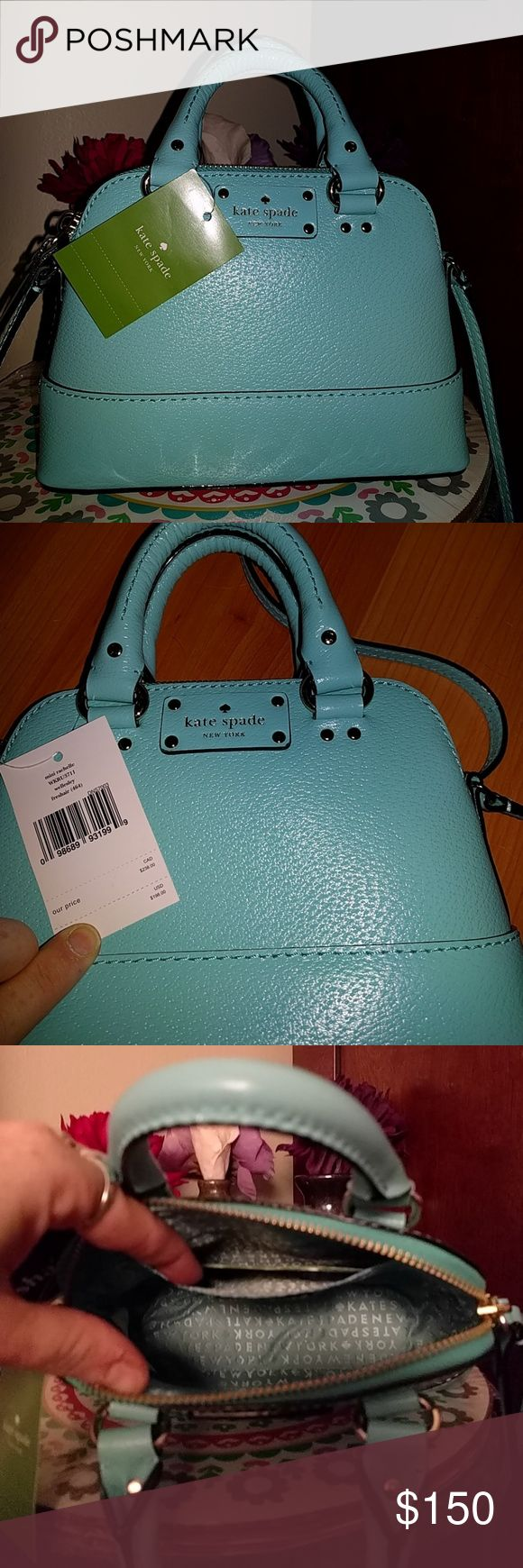 """BNWT 100% authentic Kate Spade handbag For sale is a BNWT authentic Kate Spade """"mini rachelle"""" handbag in the color """"wellesley fresh air  #464, as seen on the tag in picture 2. In picture 4, you can see that the handbag also a has an adjustable shoulder strap,  that enables you to either be use it on your shoulder or to make the purse a crossbody. Pic 4 also just shows what came inside the handbag. kate spade Bags Mini Bags"""