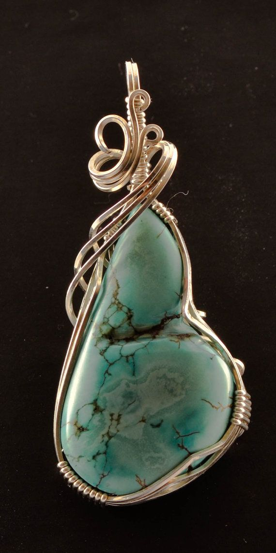 Turquoise freestyle cabochon hand sculpted in sterling silver. Measures 2 x 1 (inches)  Feel free to contact me with any further questions. Thank you