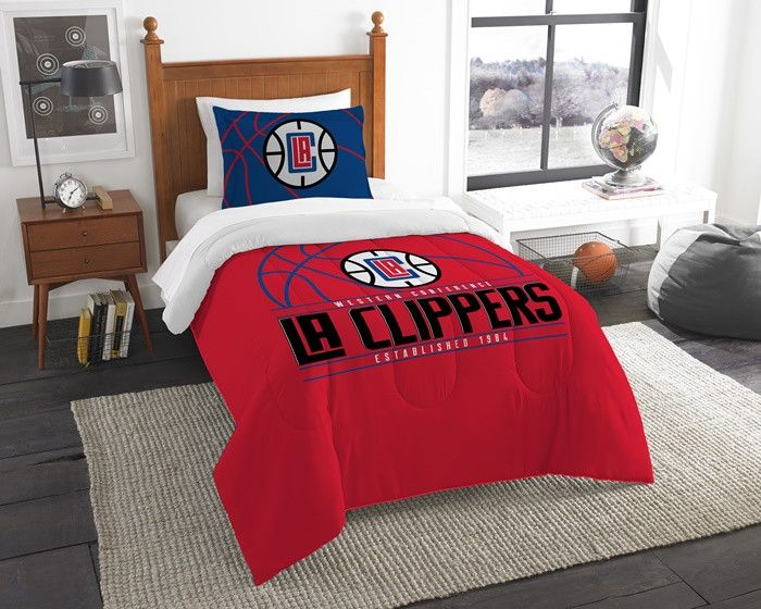Los Angeles Clippers NBA Reverse Slam Twin Comforter and Sham Set. Includes comforter and 1 sham.  Visit SportsFansPlus.com for Details.