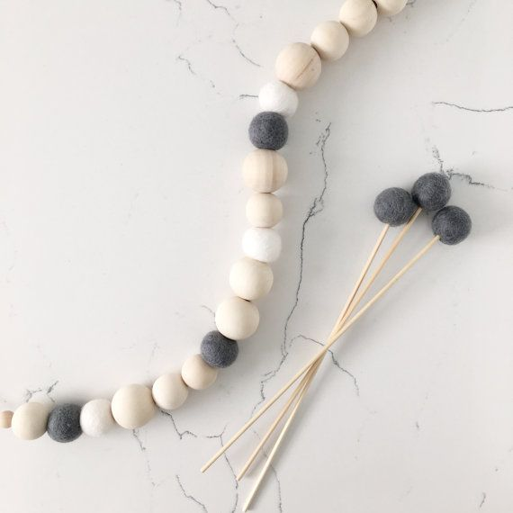 These handmade mini natural timber and felt garlands are the perfect accessory for your nursery, children's room, or even your workspace. Looking stunning in its natural and raw form this Scandi garland is finished with 3 white felt balls and 3 dark grey felt balls for neutral lovers. Hang it off a wall hook, clothes rack, or even place it over picture frames and on shelves for the perfect touch in your nursery or kiddies room. Looking for a baby shower gift idea? These garlands are great…