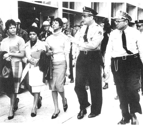 """Janice Jackson, Evelyn Pierce, and Ethel Sawyer of the Tougaloo Nine, under arrest for the crime of reading in a """"white only"""" libraray. Jackson, Mississippi, 1961."""