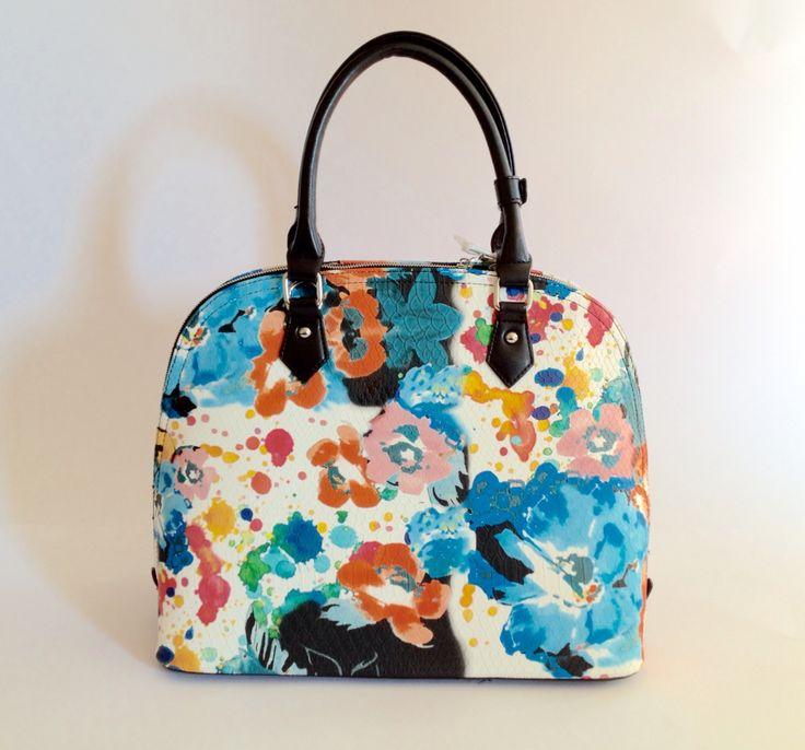 Bolso Florence cocodrilo con estampado floral. Ideal para tablet. $24.000