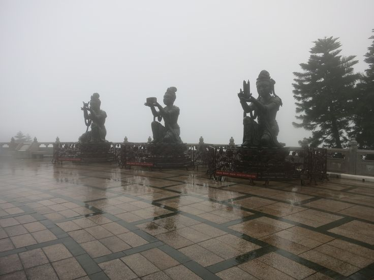 Three of the Deva statues, making offerings to the Buddha above. It started pouring with rain while I was up there.