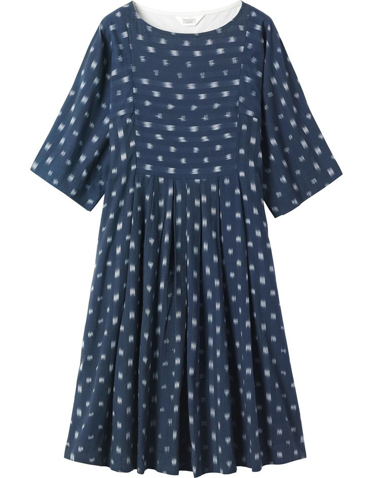 Lovely and easy, woven ikat dress with wide kimono sleeves. Front bib detail with pleats below. Wide boat-ish neck and below elbow-length sleeves.