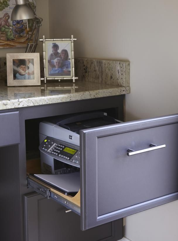 Smart Storage~ Modify a drawer beneath the desktop to hold the printer close at hand without hogging valuable counter space. A dark paint scheme defines the desk area.