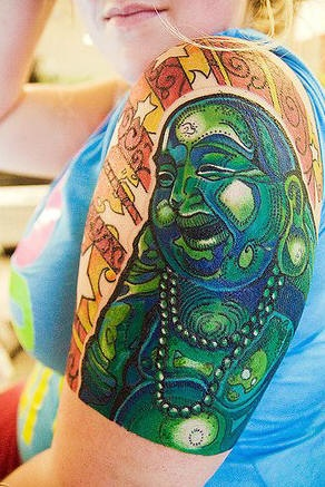 Laughing Buddha Tattoo love the colors  And the idea