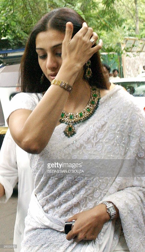Indian film actress Tabu adjusts her hair as she arrives at the wedding of actress Karishma Kapoor in Bombay, 29 September 2003. The wedding of Karishma Kapoor to her childhood friend Sanjay Kapoor was attended by a large number of filmstars and celebrities.AFP PHOTO/Sebastian D