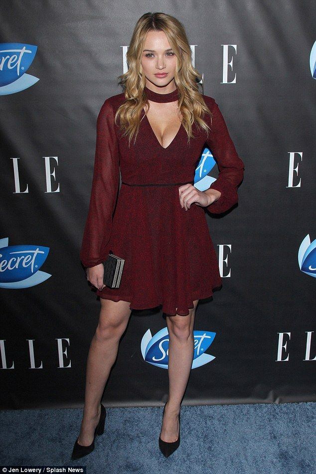 Girly flair: Actress Hunter King flashed lots of cleavage in a cute red frock