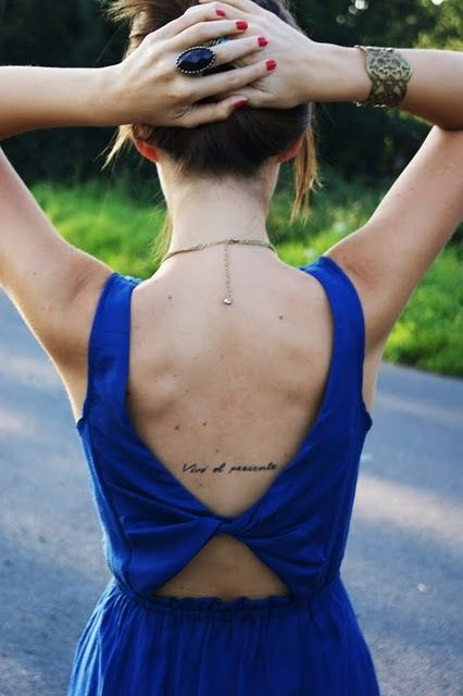 "Text tattoo on the back--would be perfectly hidden by a bra--""vive el presente"" Spanish, translates to ""live for the present"" in English 
