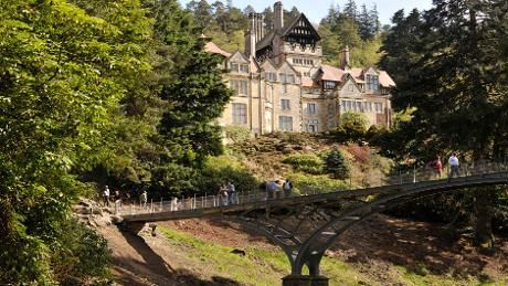 Cragside House overlooking the iron bridge and rock garden - map of estate, etc