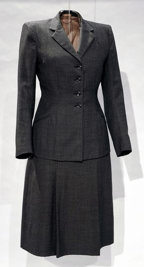 """Suit: ca. 1945, English, wool Utility suit, 1941-1952 'An """"Armar"""" Model' with the Utility mark, CC41. """"This well-cut suit was part of the wartime Utility Scheme and originally cost 16 guineas (16.16s), which was expensive."""""""