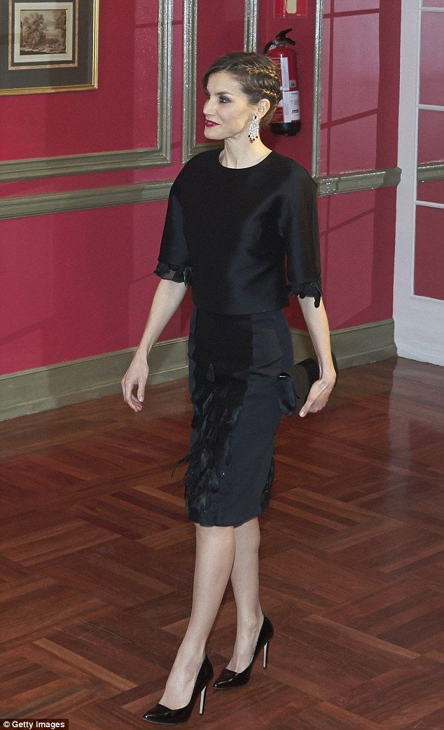 Classic look: Letizia ensured her hair and make-up took centre stage, sweeping her brunette tresses up into a slick braided updo