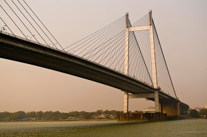 Bridge over river Ganges .. by Prabir Sen - A golden hue as the winter Sun sets ... Click on the image to enlarge.