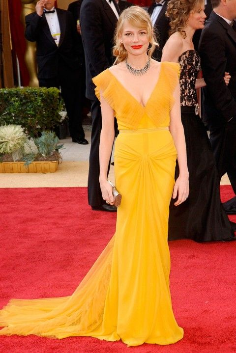 MICHELLE WILLIAMS  Michelle Williams' Vera Wang 2006 Oscars dress was a real love/hate case. Making almost an equal number of worst-dressed lists as it did best-dressed ones – many considered the canary yellow too garish for her pale skin tone. We thought she looked lovely, and the dress has now rightfully gone down in Academy Award style history. (2006)