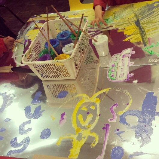 Engaging mark making!  A giant piece of silver card taped to a table!  Highly successful! #eyfs #markmaking #EAD