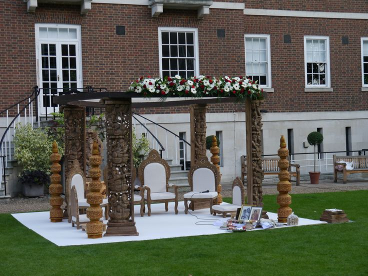 Beautiful mandap adorned by flowers in the green lawn of Middle Temple
