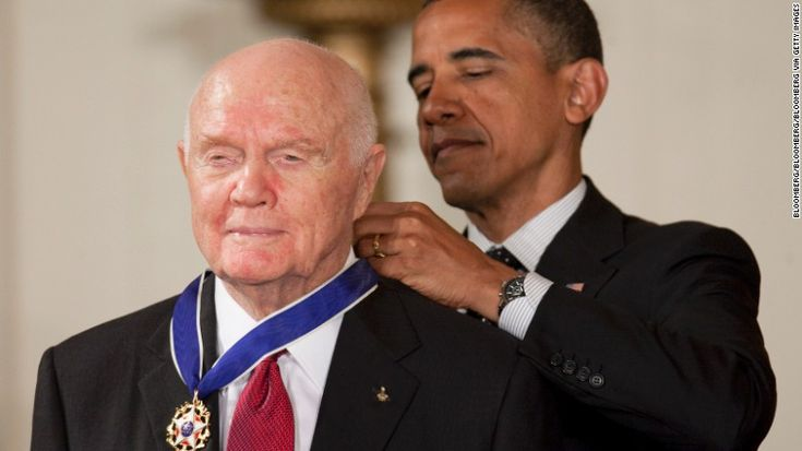 "John Glenn, former Marine Corps pilot, astronaut and U.S. Senator, left, receives the Presidential Medal of Freedom from U.S. President Barack Obama at the White House in Washington, D.C., U.S., on Tuesday, May 29, 2012. The Medal of Freedom is the nation's highest civilian honor. Photographer: Andrew Harrer/Bloomberg via Getty Images ""R.I.P. 12/8/16"""