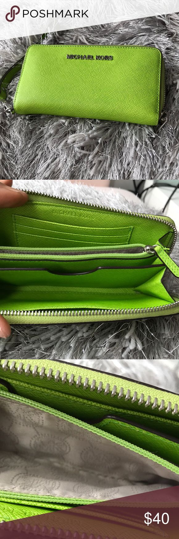 Michael Kors Wallet Wristlet I am selling a Michael kors wallet in good condition. Includes space for cash, credit cards and change. Light scratches on wallet see pictures. Michael Kors Bags Clutches & Wristlets
