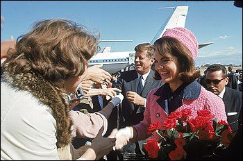Jacqueline Kennedy's pink suit was made in 1961 by the New York dress salon, Chez Ninon. It was a copy of a Chanel pink boucle wool suit trimmed with a navy blue collar.