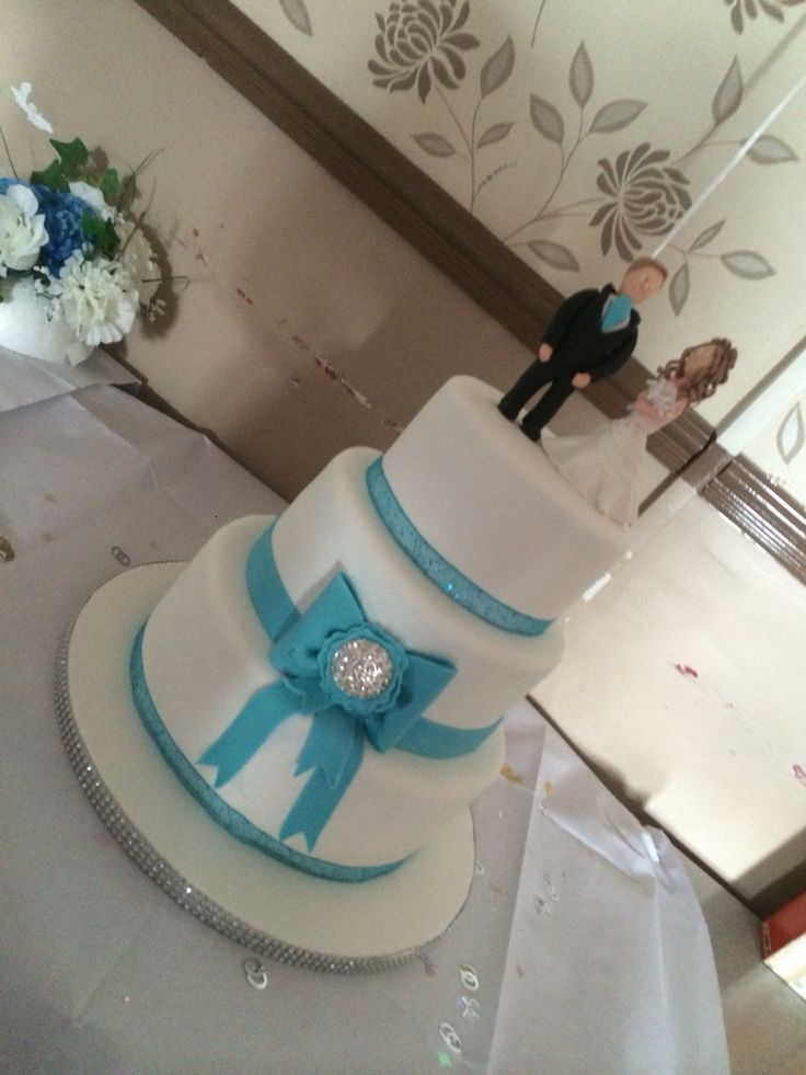 Teal bow with broach 3 tier cake