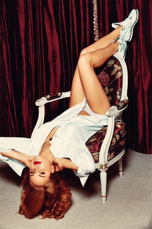 Lana Del Rey pin up style on chair with converse and curtains