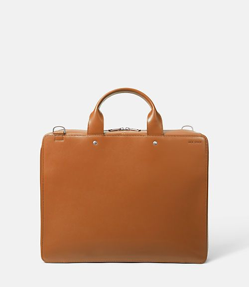 "Our Walker Leather File Case is a functional, sophisticated full-size briefcase. Constructed from smooth water-resistant leather, the durable bag is detailed with custom Jack Spade hardware. Purposeful features include a removable shoulder strap, multiple organizing pockets, and full lining. 12.6""H x 16.2""W x 3.0""D"