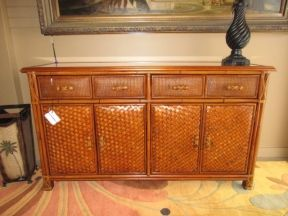 """02  Tropical style buffet in a warm finish. This buffet has a glass top with four drawers on top and two doors below. 60""""long x 18""""deep x 34""""high."""