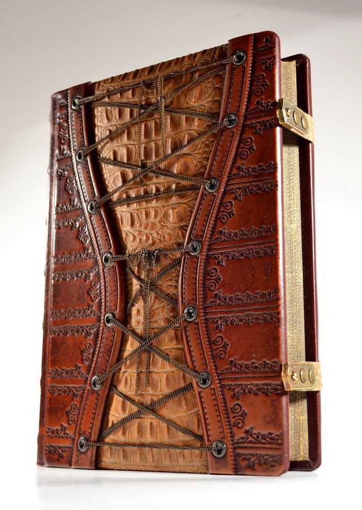 Sumptuous baroque hand made leather journal. An exquisitely rich detailed embossed book for your thoughts …. hand tinted leather creating an unique colour gradient . The centre of the front cover presents alligator texture within patina brass chains.. Book edges are carved and colored with dark tones and partially gilded with specialist bookmakers antique finish We are informed … 'It feels like Game of Thrones meets Baroque opulence' https://www.facebook.com/alexlibris.bookart