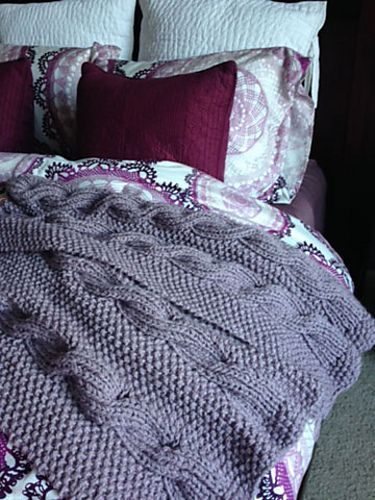 Free Knitting Pattern for Wintry Cable Afghan Reversible Blanket - Carole Dietrich's reversible afghan pattern uses a ribbed cable and moss/seed stitch, so it looks the same on both sides.