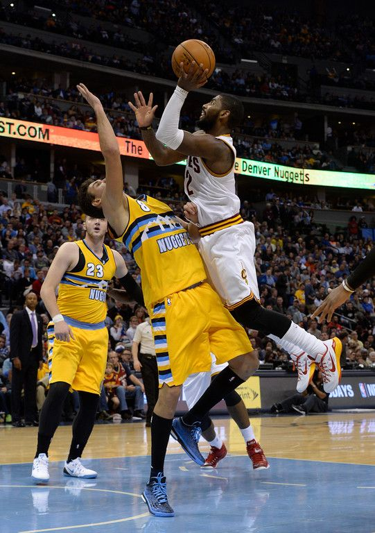 Description of . DENVER, CO - NOVEMBER 07:  Cleveland Cavaliers guard Kyrie Irving #2 shoots against Denver Nuggets forward Danilo Gallinari #8 in the third quarter Friday evening at the Pepsi Center November 07, 2014. (Photo by Andy Cross/The Denver Post)