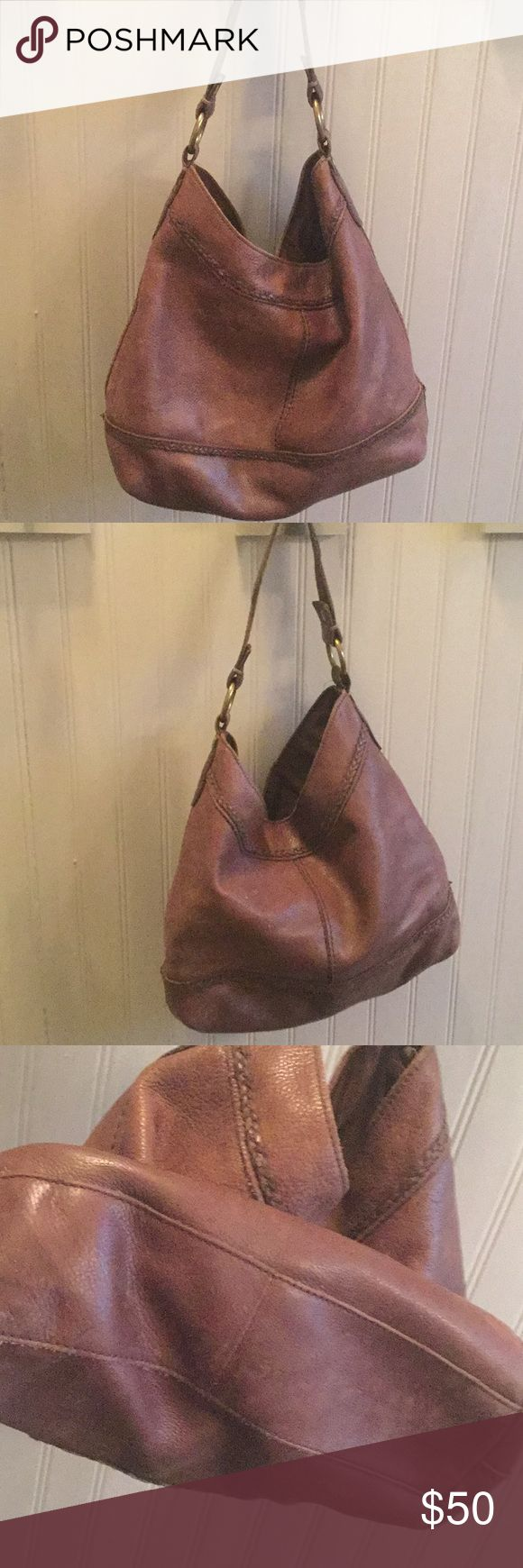 Large leather slouch bag Lucky brand large leather slouch bag with slightly distressed leather. Inside are 2 side pockets and one larger zip pocket. I absolutely love this bag!! Lucky Brand Bags Shoulder Bags