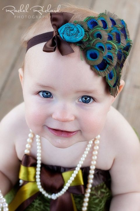 peacock feather headband with silk dupioni rolled flower and bow for baby toddler or big girls you choose color of headband. $19.00, via Etsy.