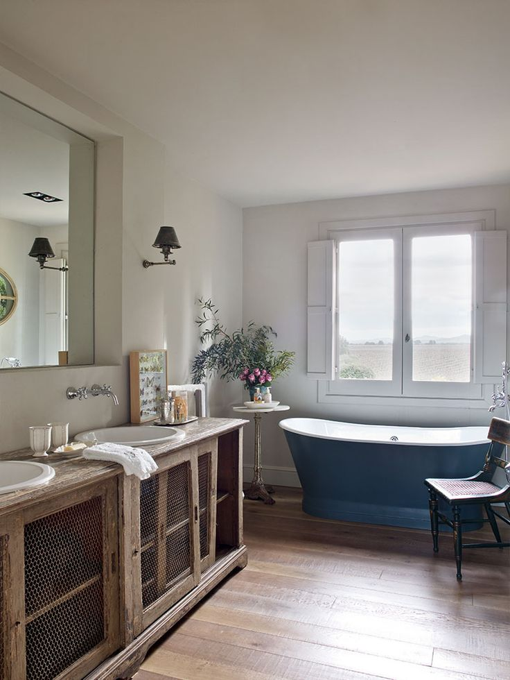 Isabel Quesada Lopez bath, blue tub, custom vanity with sliding doors