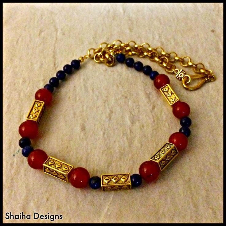 "This+stunning+necklace+portrays+richness+with+the+semi-precious+gemstones+of+Lapis+Lazuli+and+Carnelian+complete+with+golden+beads+and+a+beautiful+brass+chain.++It+is+20+1/2""+long+and+finished+with+a+beautiful+golden+hook+clasp."