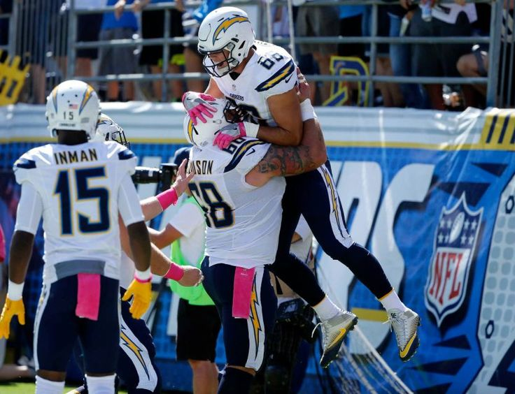 Saints vs. Chargers Updated October 2, 2016  -  35-34:      San Diego Chargers tight end Hunter Henry, top, is lifted by teammate Matt Slauson after scoring a touchdown during the first half of an NFL football game against the New Orleans Saints, Sunday, Oct. 2, 2016, in San Diego.